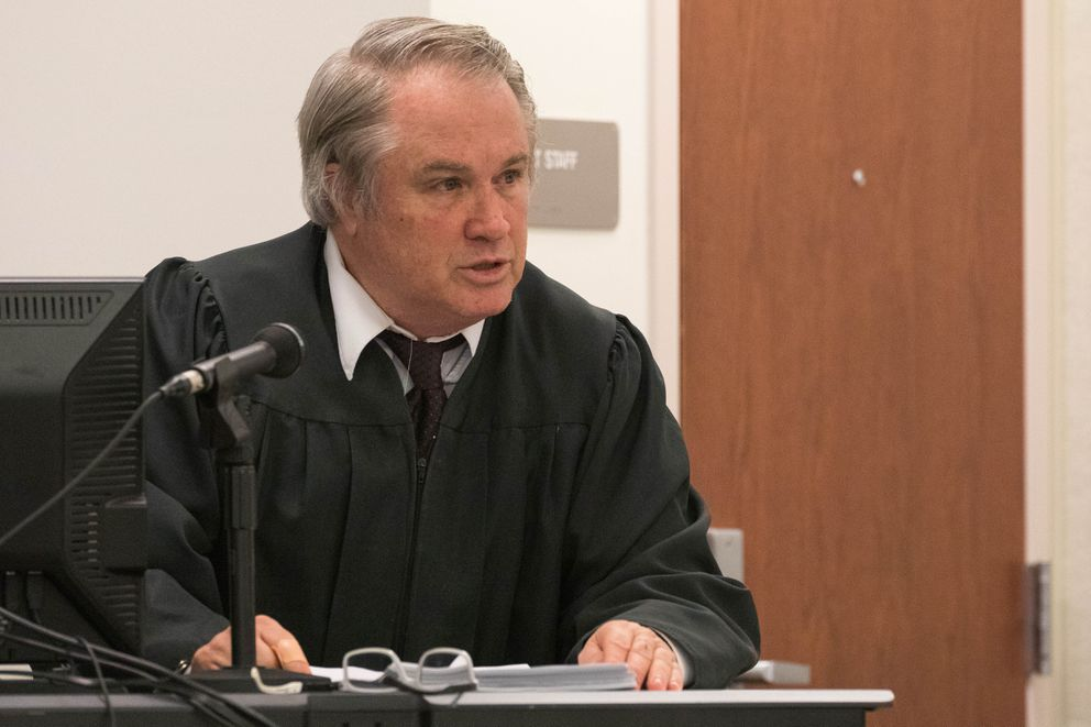 Judge Gregory Heath reads jury instructions before closing arguments Wednesday. (Loren Holmes / ADN)