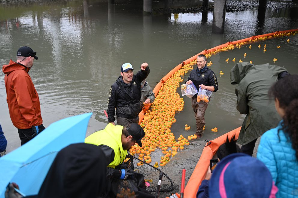 Jason Motyka, a co-founder of 49th State Brewing Company and one of the organizers of The Great Alaska Duck Race, addresses a crowd of spectators on the bank of Ship Creek in Anchorage on Saturday, September 7, 2019. (Jeff Parrott / ADN)