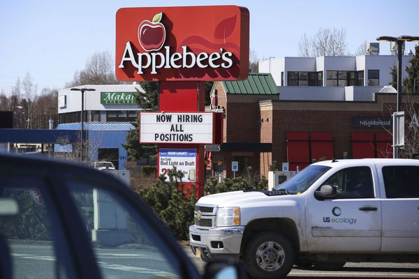 A notice of employment opportunities is posted on an Applebee's sign outside the restaurant on the corner of W. Tudor Road and C Street in Anchorage on Friday, April 30, 2021. (Emily Mesner / ADN)