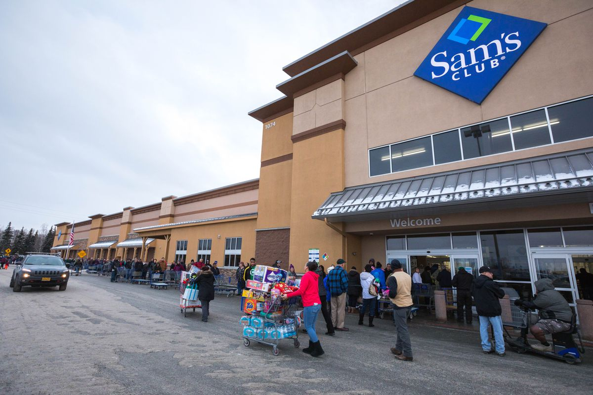 Hundreds of people wait in line to get into Sam's Club on Jan. 12 at Tikahtnu Commons in Anchorage. Sam's Club announced that they were closing all three of their Alaska locations at the end of the month, and they offered 25% off most items on Jan. 12. (Loren Holmes / ADN)