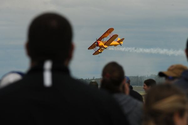 Marcus Paine preforms with his PT17 Boeing Sherman biplane during the Arctic Thunder air show at Joint Base Elmendorf-Richardson on Saturday, July 30, 2016 in Anchorage. (Bob Hallinen / Anchorage Daily News)