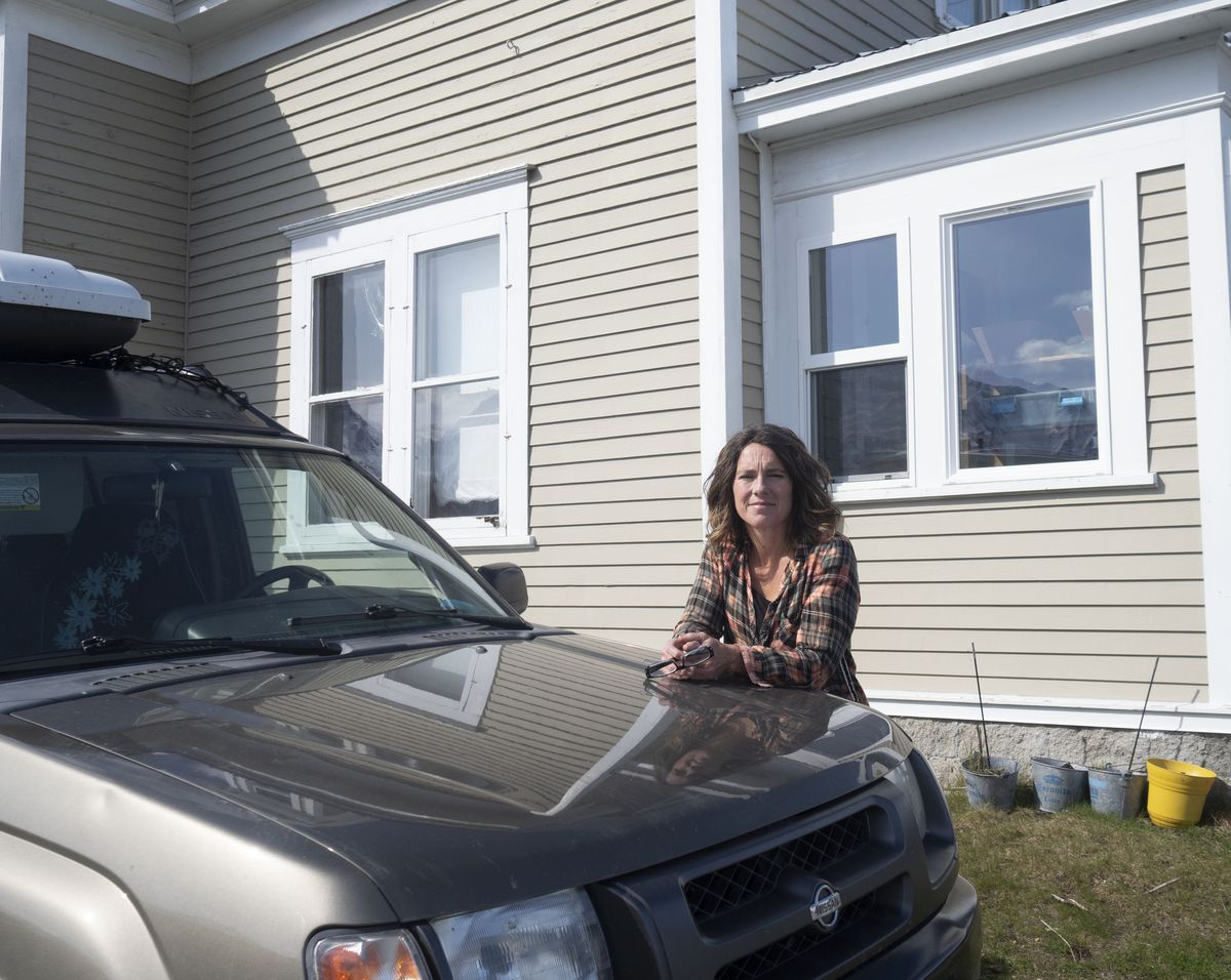 Leslie Ross of Haines in front of her home and bed-and-breakfast on Friday, May 1, 2020. (Photo by John Hagen)