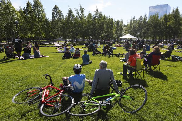 People listen to live music during a concert, part of the free public event series, Anchorage Summer Arts in the Park, on the front lawn of the Anchorage Museum in downtown Anchorage on Friday, June 4, 2021. (Emily Mesner / ADN)
