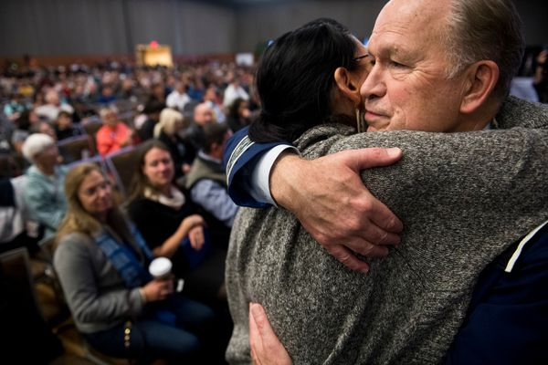Gov. Bill Walker is hugged by a supporter after his announcement. Gov. Bill Walker announced that he's suspending his campaign for election at the Alaska Federation of Natives annual convention on October 19, 2018. (Marc Lester / ADN)