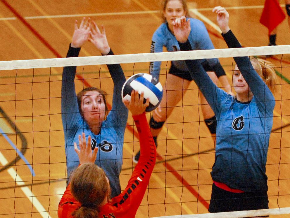 Chugiak's Shannon Luna, left, and Ellie Scherffius go up for a block at last week's Chugiak Invitational volleyball tournament. (Matt Tunseth / ADN)