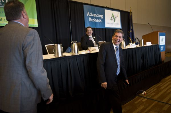 Mike Dunleavy, left, talks with fellow gubernatorial candidates Billy Toien and Mark Begich before the start of the event. Four candidates for governor participated in a lunchtime forum hosted by the Anchorage Chamber of Commerce at the Dena'ina Center on September 10, 2018. (Marc Lester / ADN)
