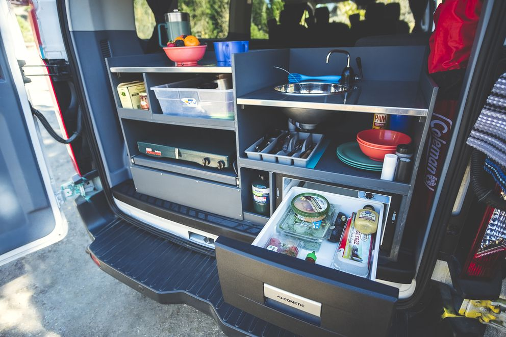 Escape Campervans' kitchen is accessible in the rear of the van, complete with refrigerator, propane cookstove, sink and storage. (Photo courtesy Escape Campervans)