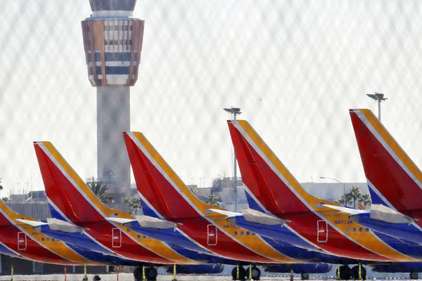 Boeing 737 Max jets are grounded at Sky Harbor International Airport, Thursday, March 14, 2019 in Phoenix. The U.S. issued an immediate emergency order Wednesday, grounding all 737 Max 8 and Max 9 aircraft in the wake of the crash of an Ethiopian Airliner. (AP Photo/Matt York)