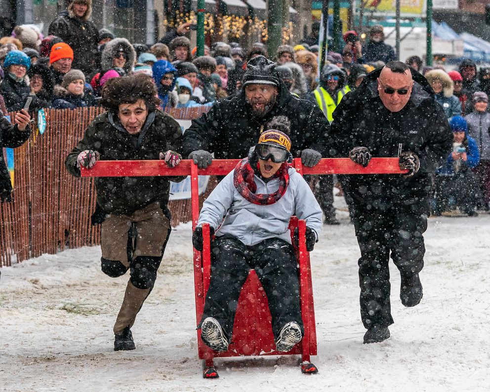 A team competes in the Fur Rondezvous outhouse races on Saturday, Feb. 29, 2020 in Anchorage. (Loren Holmes / ADN)