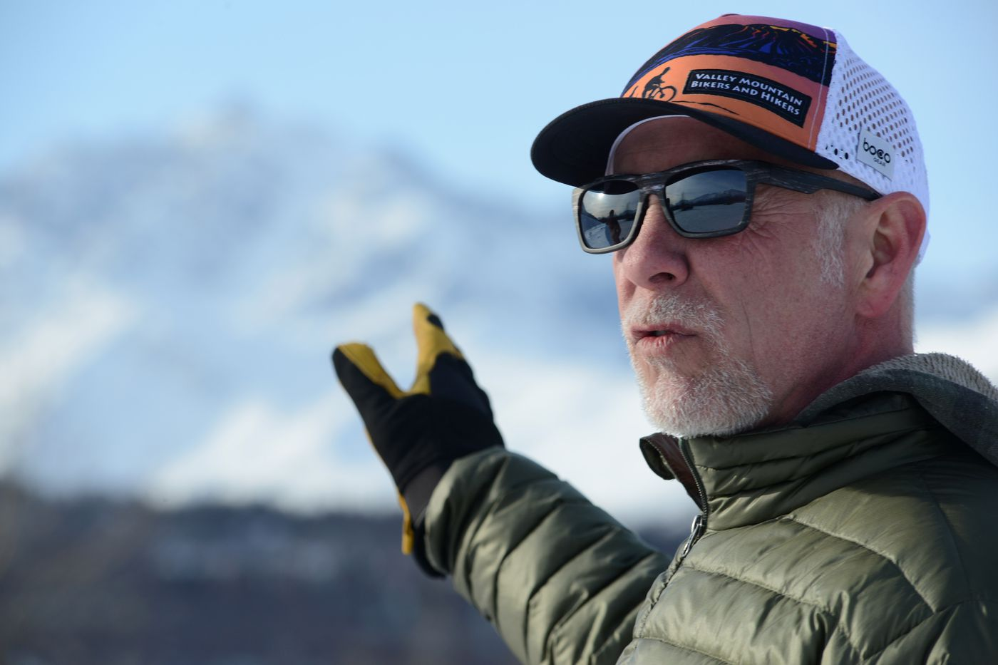 Tom Faussett talks about access to the trail leading to Knik Glacier on Wednesday, March 24, 2021. Faussett owns a business on the south side of the Knik River and has carved out a parking lot on his property for bikers to use. (Anne Raup / ADN)