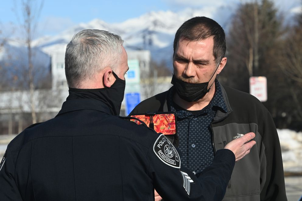 Damion Turchetto speaks to Anchorage Police after he was trespassed from the Anchorage Assembly meeting on Tuesday, April 13, 2021. (Bill Roth / ADN)