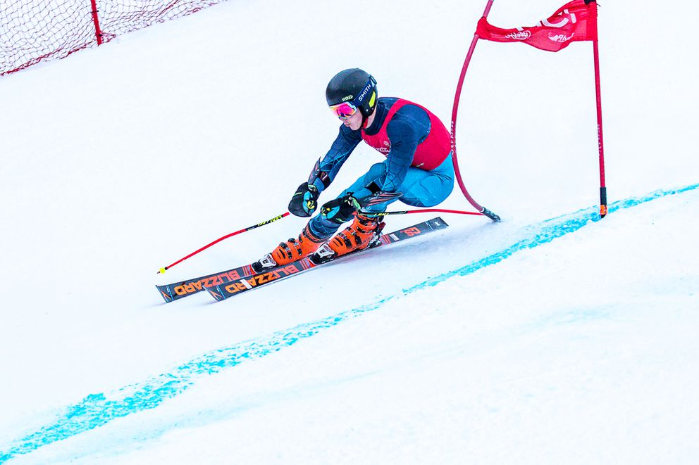 Kevin Leach blasts past a gate on the steep final pitch of Saturday's giant slalom course. (Photo by Bob Eastaugh)