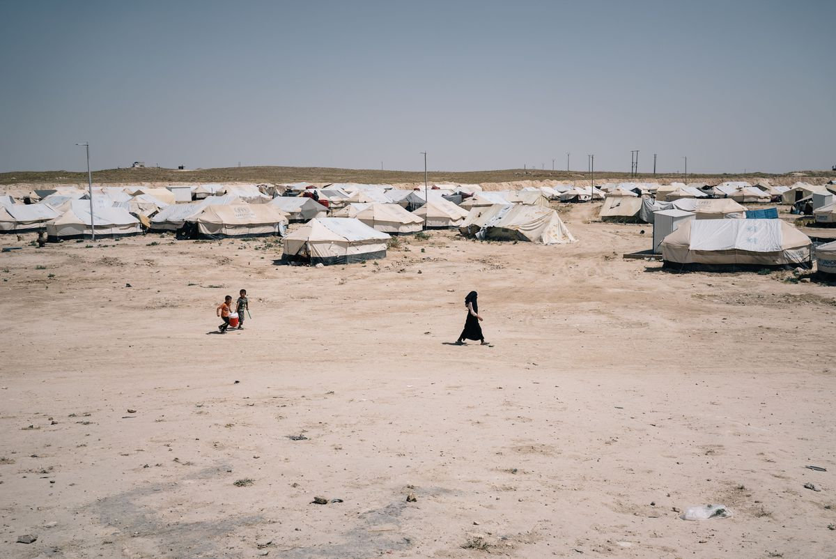 Children walk through the al-Hol camp in Syria. (Photo for The Washington Post by Alice Martins)