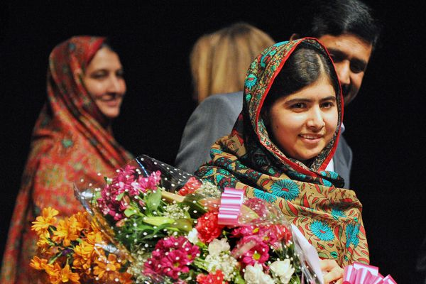 OPINION: Nobel Peace Prize winner Malala Yousafzai may live far from Pakistan now, but her courage still rings true in the voices of girls and boys going to school together in her home town. Pictured: Malala with her mother, Tor Pekai, and father Ziauddin at a press conference after she won a share of the 2014 Nobel Peace Prize.