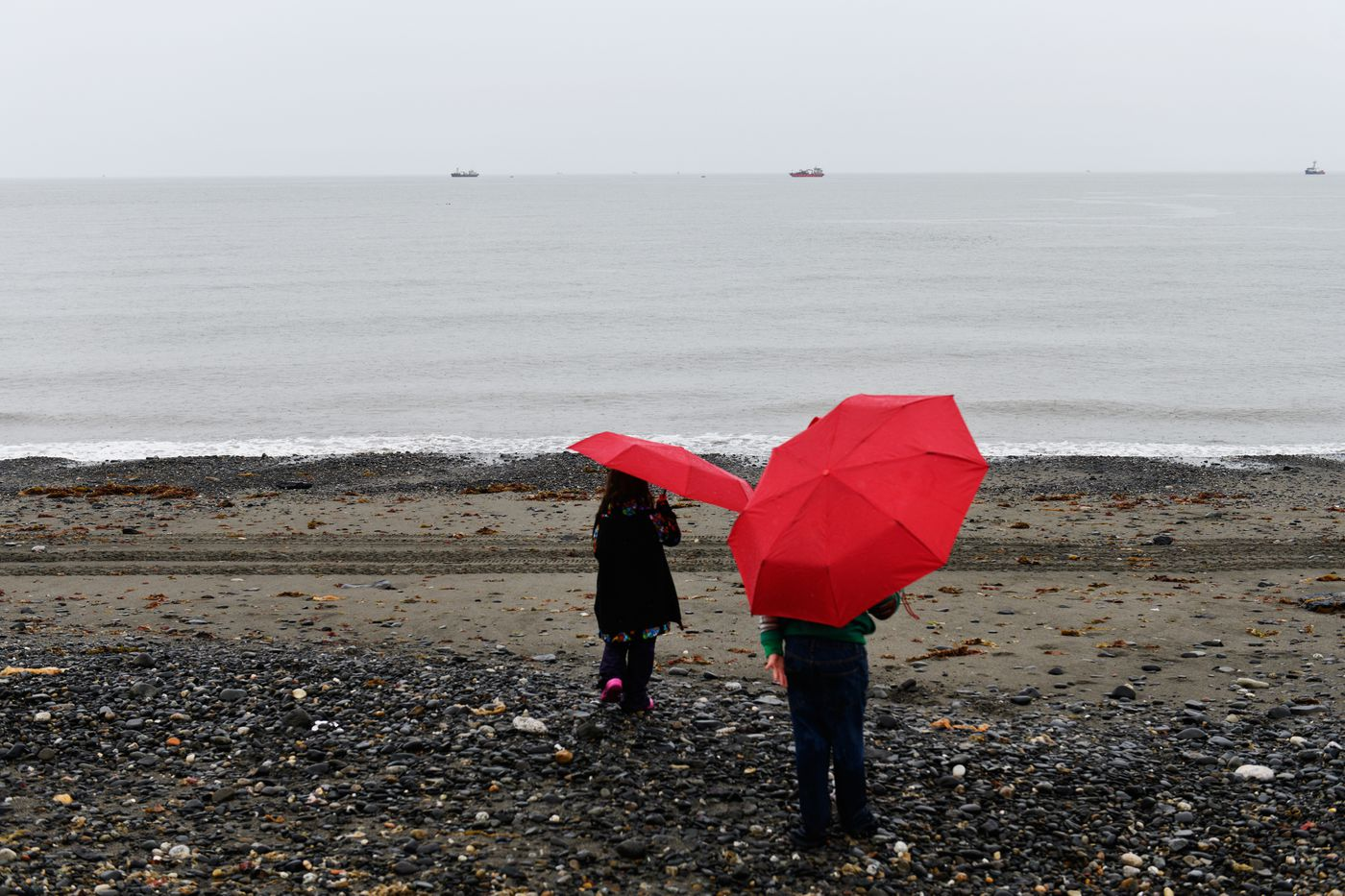 Children play in the rain during the Alaska Heathenry gathering. (Marc Lester / ADN)