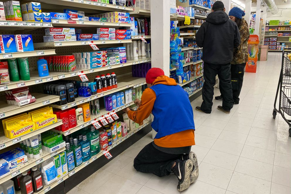 Sydney Sarren stocks shelves at the Unalakleet A/C store on Saturday, March 14, 2020. Most items are in stock at the store, one of two general stores in the community. (Loren Holmes / ADN)