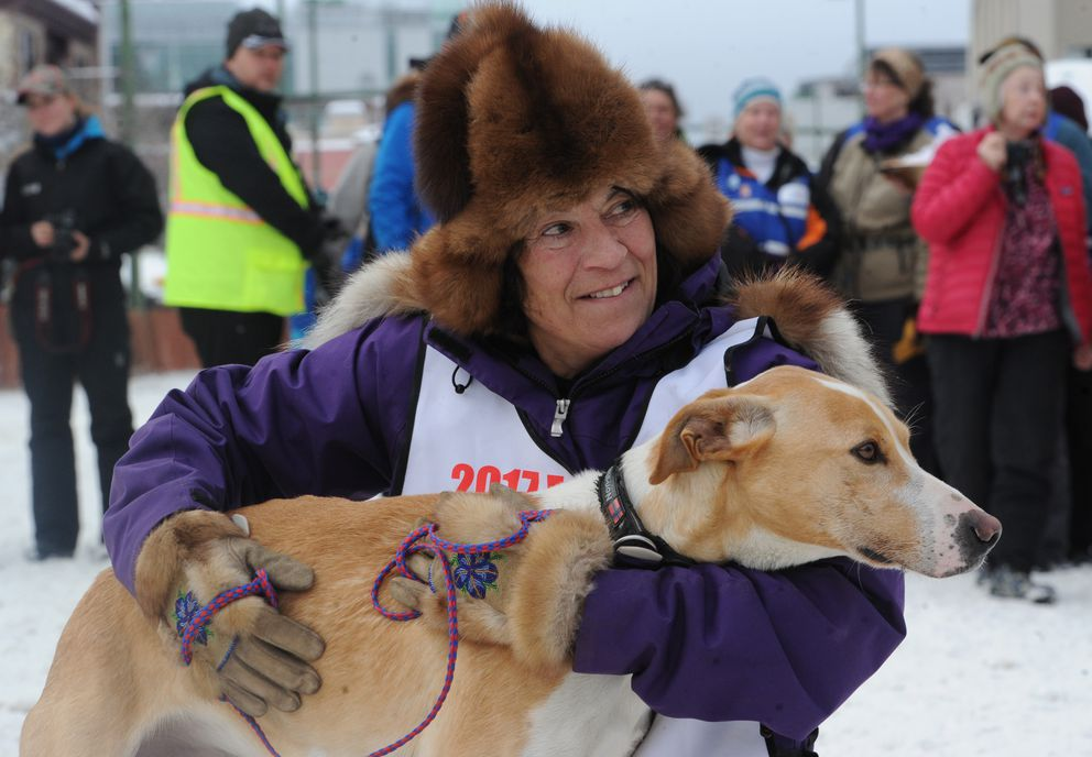 Roxy Wright with lead dog Cloud after winning the Fur Rendezvous Open World Championship sled dog race last month. (Bill Roth / Alaska Dispatch News)