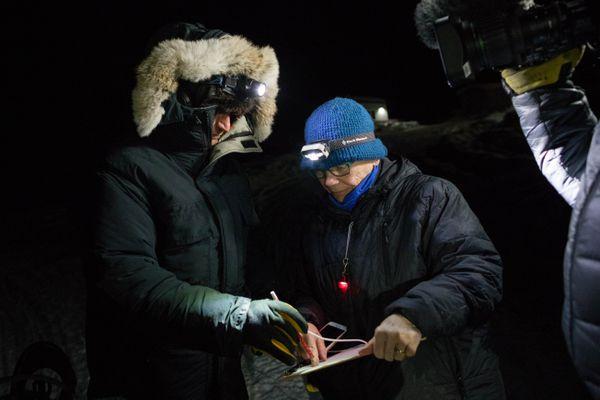 Volunteer NJ Gates checks in Nicolas Petit at 5:21 AM in Anvik on March 9, 2018. (Loren Holmes / ADN)
