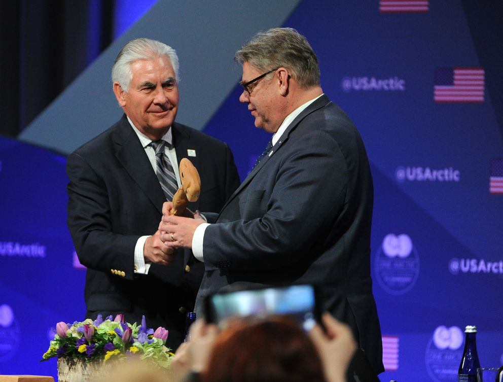 U.S. Secretary of State Rex Tillerson handed a gavel to Finland's minister of foreign affairs, Timo Soini, the new chair of the international Arctic Council at the Carlson Center in Fairbanks, Alaska on Thursday. (Bob Hallinen / Alaska Dispatch News)
