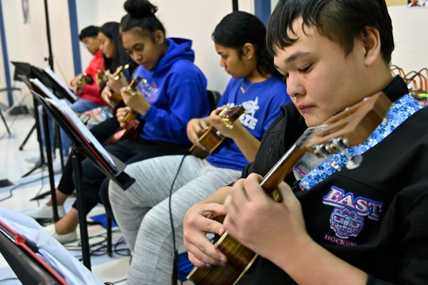 East High junior John Hamner, right, plays with other members of East High Ukulele during a class on November 20, 2019. (Marc Lester / ADN)