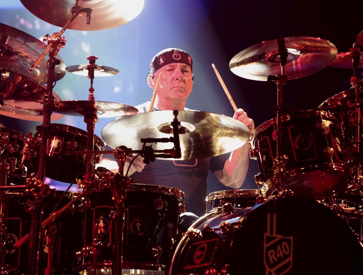 This June 25, 2015 file photo shows Neil Peart of the band Rush performing in concert during their R40 Live: 40th Anniversary Tour in Philadelphia. Peart, the renowned drummer and lyricist from the band Rush, has died at age 67. (Photo by Owen Sweeney/Invision/AP, File)