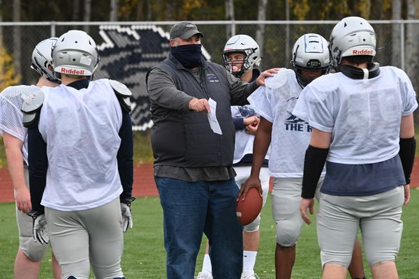 Eagle River Wolves second year head football coach Brad Myers works with players during football practice on Tuesday, Sept. 29, 2020, as they prepare for their upcoming game against the Bartlett Golden Bears. (Bill Roth / ADN)