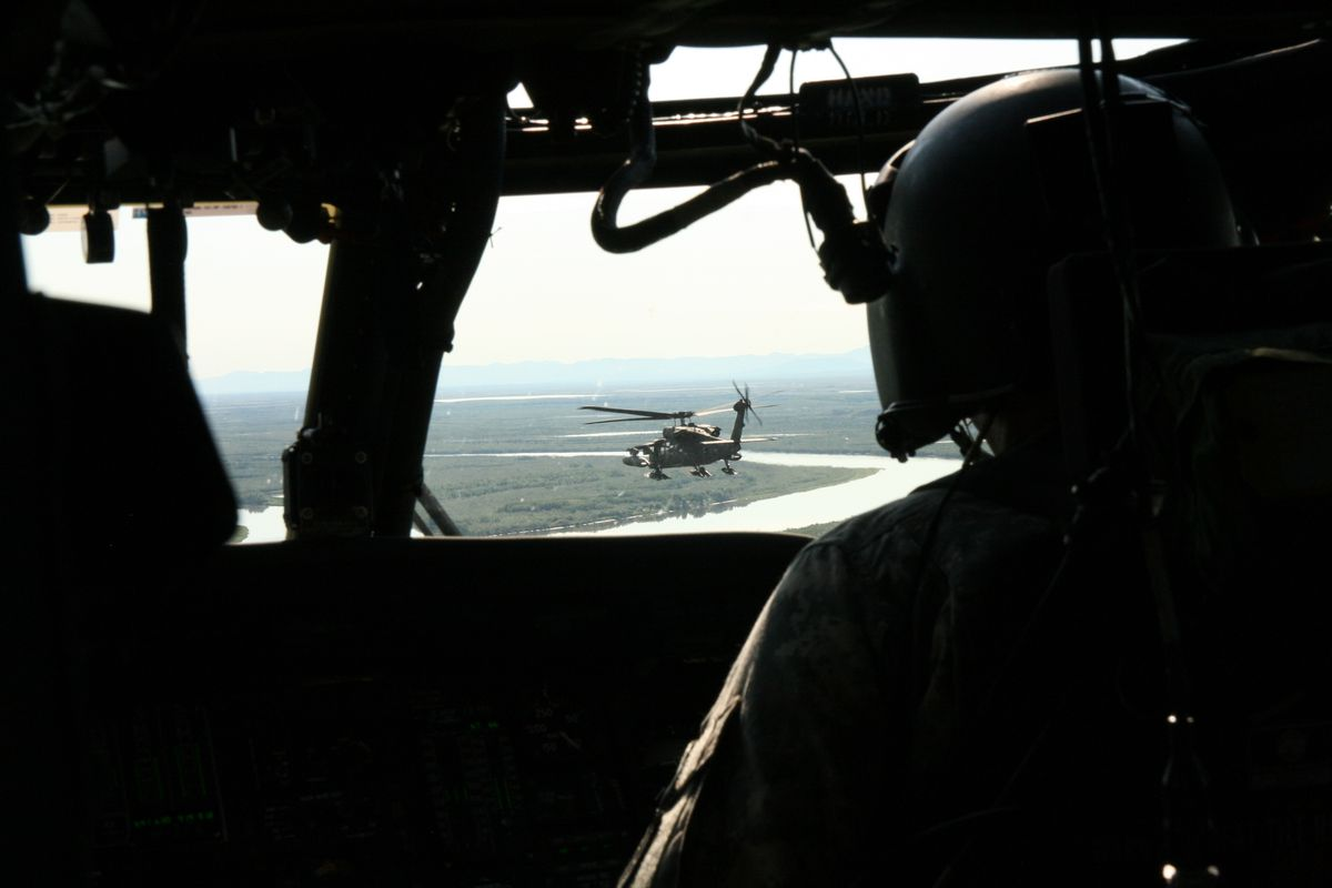 Two helicopters carrying Alaska National Guard and U.S. Army leaders fly on Tuesday, June 7, from Bethel to Kwethluk. (Lisa Demer / Alaska Dispatch News)
