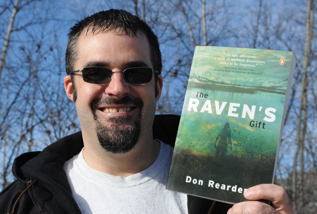 Author Don Rearden holds his book The Raven's Gift in March 2011. (Bill Roth / ADN archive 2011)