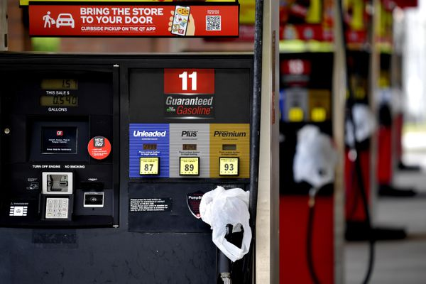 A QuickTrip connivence store has bags on their pumps as the station has no gas, Tuesday, May 11, 2021, in Kennesaw, Ga. Colonial Pipeline, which delivers about 45% of the fuel consumed on the East Coast, halted operations last week after revealing a cyberattack that it said had affected some of its systems. (AP Photo/Mike Stewart)