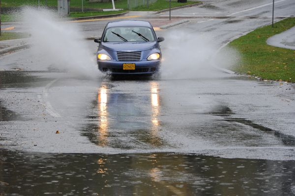 Rain puddles formed on Spenard Road near Chester Creek during the downpour on Wednesday, Sept. 18, 2019. (Bill Roth / ADN)