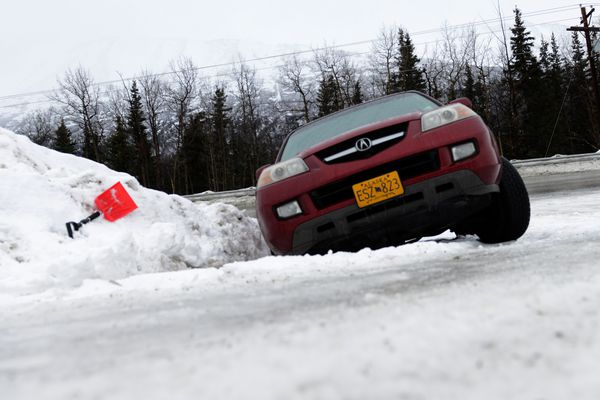 A car rests in the ditch just off of Eagle River Road in Eagle River, Alaska, on Thursday, Jan. 26, 2017. Warm weather and rain brought dangerous driving conditions to southcentral roads. (Bob Hallinen / Alaska Dispatch News)