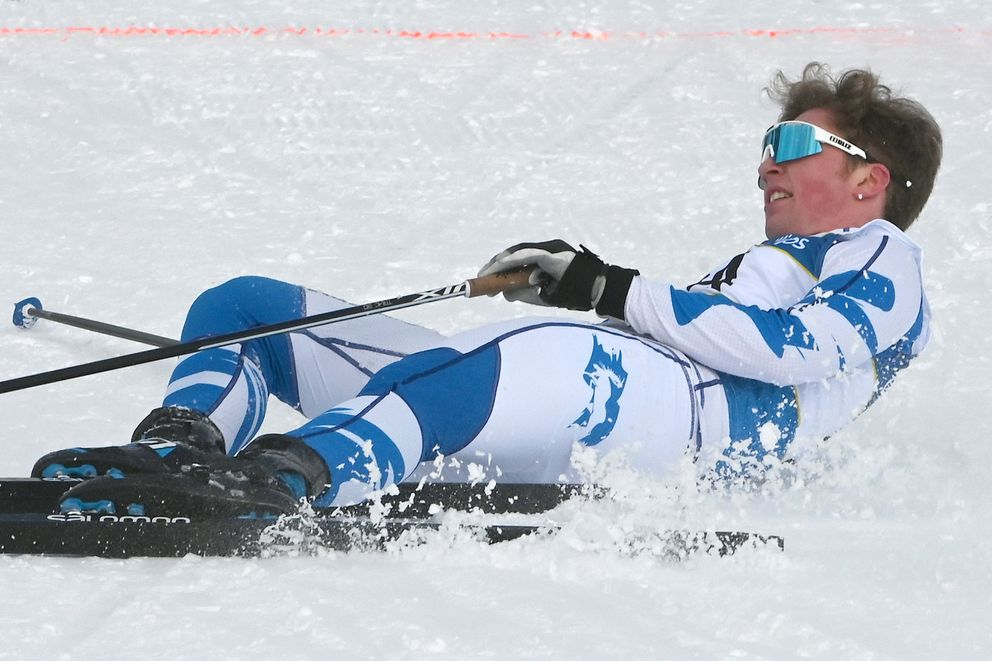 Palmer senior Joseph Walling slides to a stop after his sixth-place finish. (Bill Roth / ADN)