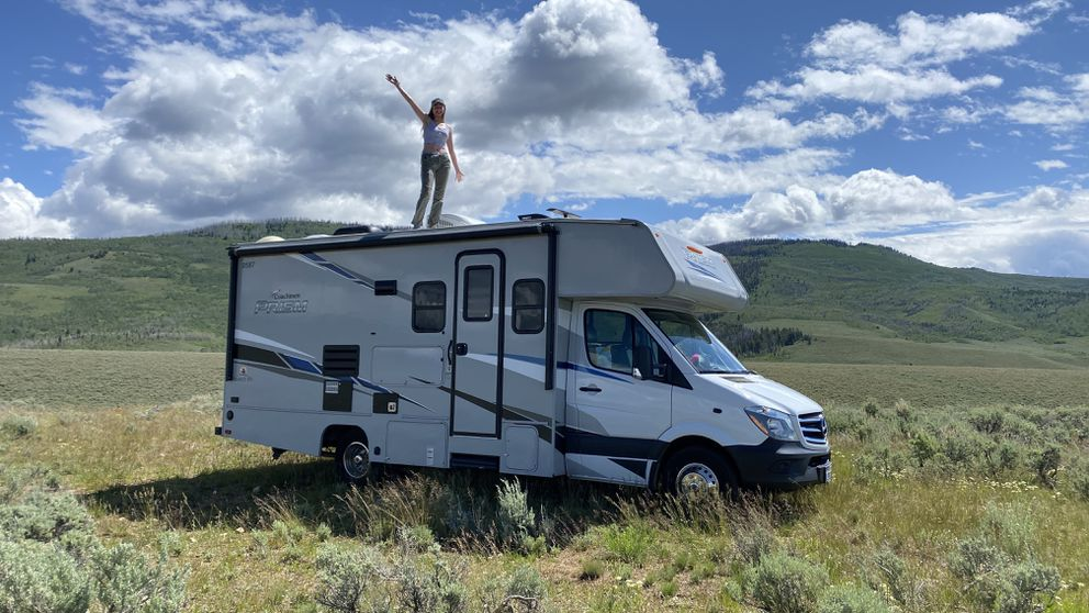 "Madeline Lohse strikes a pose atop her ""land yacht"" in Wyoming. (Photo by Mike Lohse)"