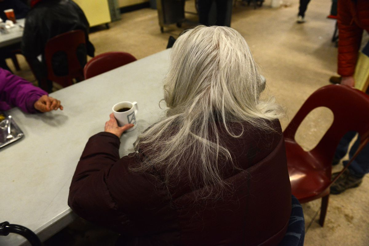 Virginia Cook, 76, who was released to the Brother Francis homeless shelter from Alaska Psychiatric Institute on Nov. 22, is pictured Friday as she sips coffee at Bean's Cafe in Anchorage. State officials who control Cook's money have not allowed her to travel to family. (Bob Hallinen /ADN)
