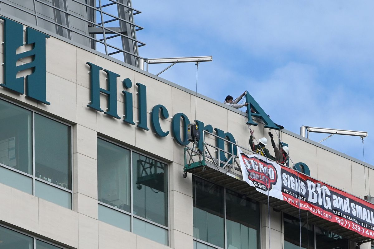 Workers with Signco Quality Signs worked 200 feet in the air as they finished installing the Hilcorp Alaska sign on the JL Tower, Anchorage's fourth tallest building, on Thursday, June 4, 2020. (Bill Roth / ADN)