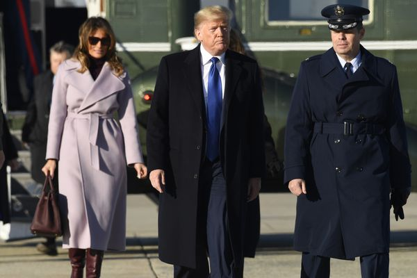 President Donald Trump and first lady Melania Trump walk up the steps of Air Force One at Andrews Air Force Base in Md., Friday, Jan. 17, 2020. The Trumps are heading to Florida to spend the weekend at their Mar-a-Lago estate. (AP Photo/Susan Walsh)