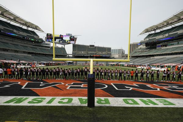 The Cincinnati Bengals stand arm in arm as