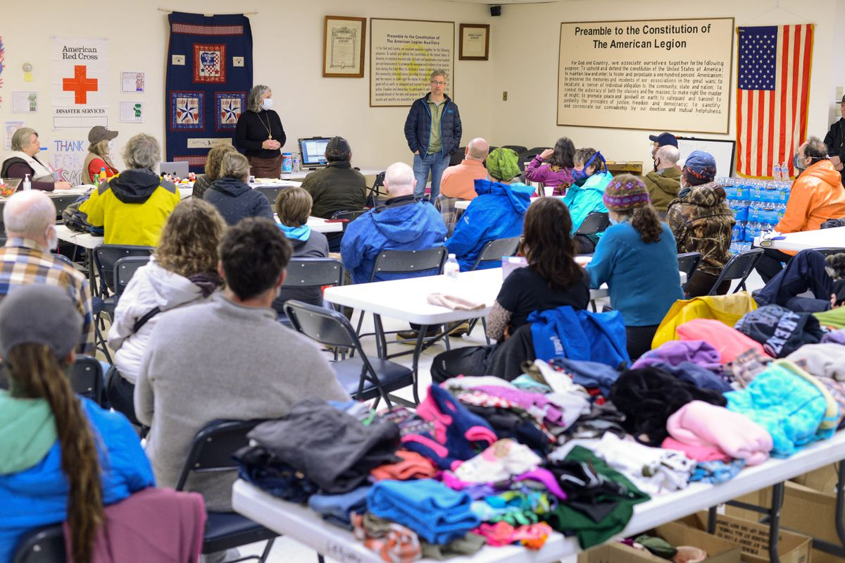 Haines Borough Mayor Douglas Olerud answers questions from evacuees on Saturday, Dec. 5, 2020 at Haines' American Legion hall, now a center for evacuees. (James Brooks / ADN)