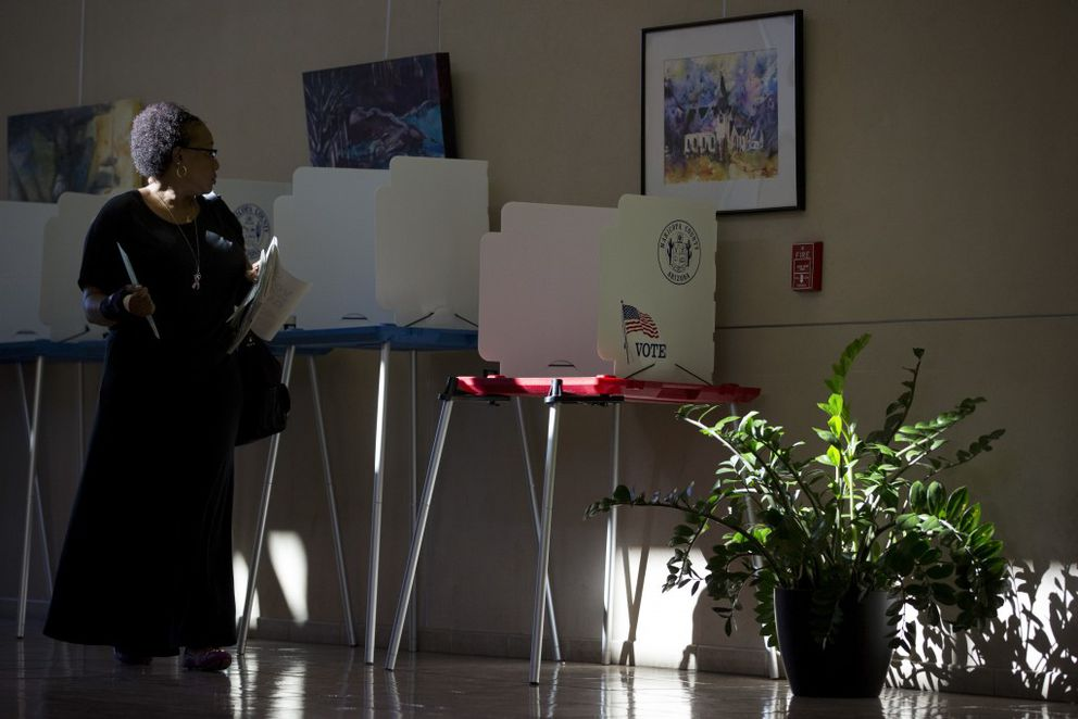 A voter casts a ballot at an early voting station in the city clerk's offices in Avondale, Ariz., Oct. 12, 2016. A decision to send special election observers to only four states on Election Day worries civil rights advocates, but officials say their hands are tied by a Supreme Court ruling. (Caitlin O'Hara/The New York Times)