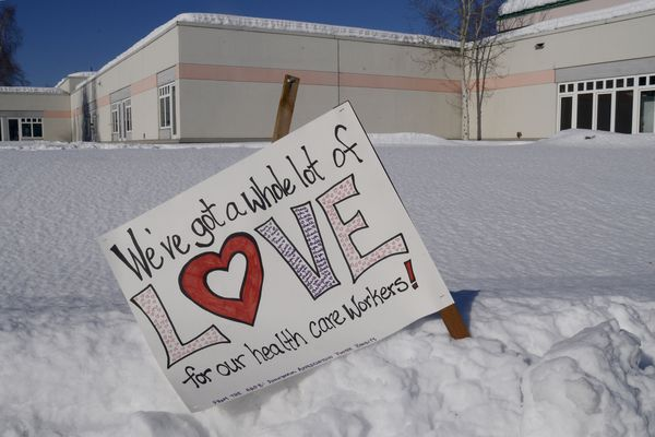 A sign supporting health care workers during the COVID-19 pandemic was placed in front of the Fairbanks Health Partners Denali Center by the Anonymous Appreciation Poster Bandits (AAPD) in Fairbanks, Alaska Tuesday afternoon, March 31, 2020. (Photo by Eric Engman)