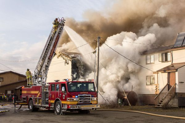 A fire burned through a Nome eight-unit multiplex Thursday night, September 25, 2014, injuring two and displacing more than 20 people. The building was gutted despite more than an hour of active firefighting.