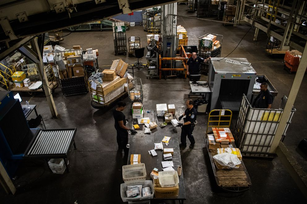 CBP officers scan packages at the John F. Kennedy International Airport mail facility in New York on Sept. 7, 2018. (Washington Post photo by Salwan Georges)