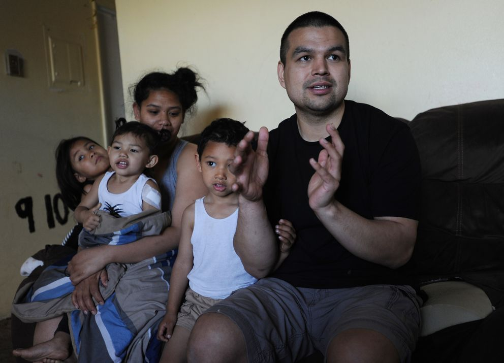 Sammy Murphy describes taking care of his 2-year-old daughter Kapua Murphy, second from left, after she was hit by a bullet during a shooting in Fairview last week. Kuulei Steele sits with daughter Leilani Mahoe, 5, and Sammy Murphy, Jr., 3, in their Fairview apartment. (Bill Roth / ADN)