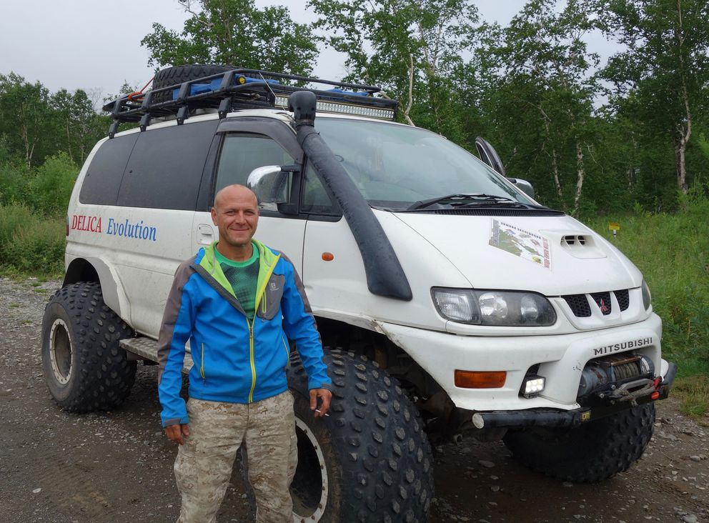 Our guide, Segei, of Red Rivers, poses with his tricked-out Mitsubishi mud-bogger. We needed it to traverse the roads into a nearby Kamchatkan nature preserve. (Scott McMurren)