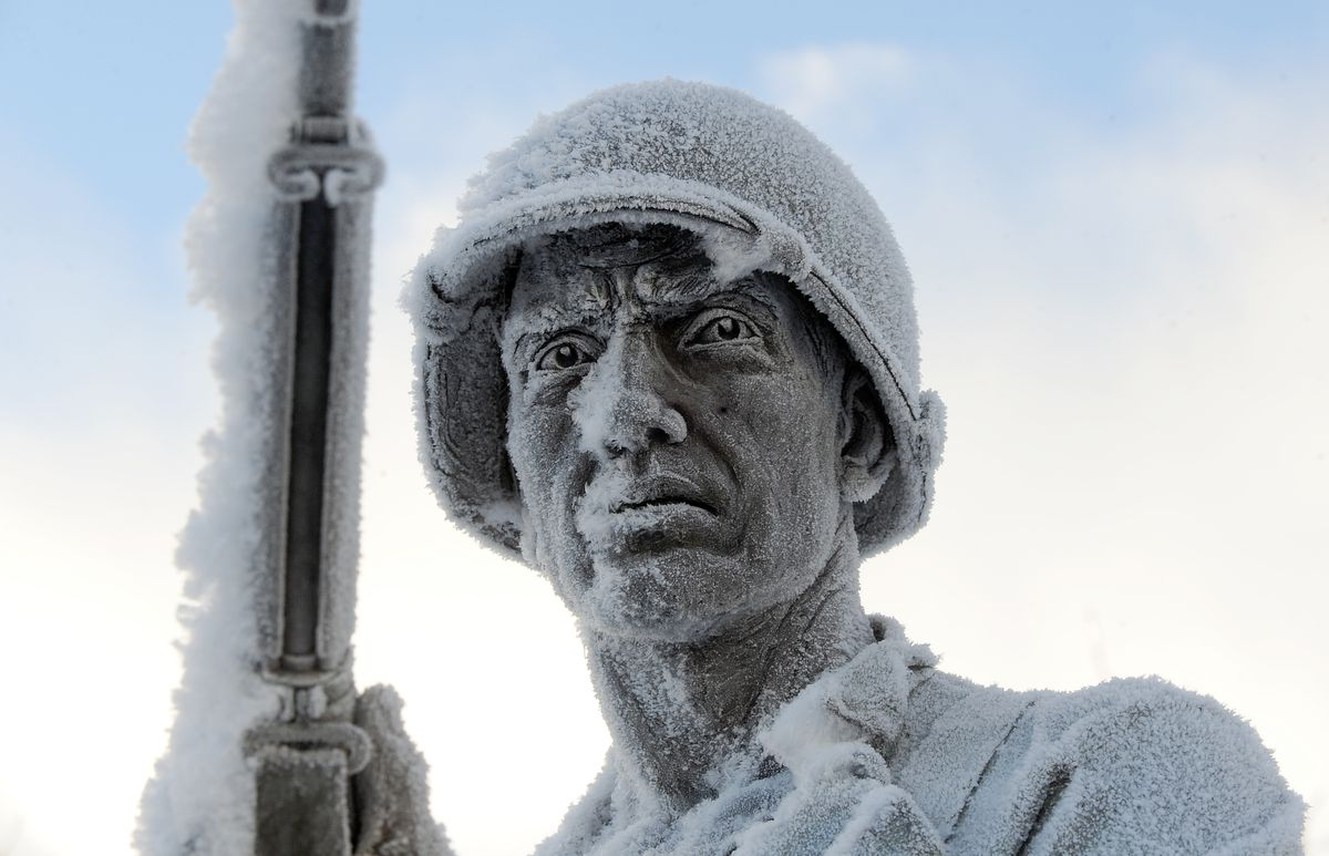 Frost covers the statue of a soldier at the Anchorage Veteran's Memorial on the Park Strip in Anchorage on Dec. 28, 2017. (Bob Hallinen / ADN archive)