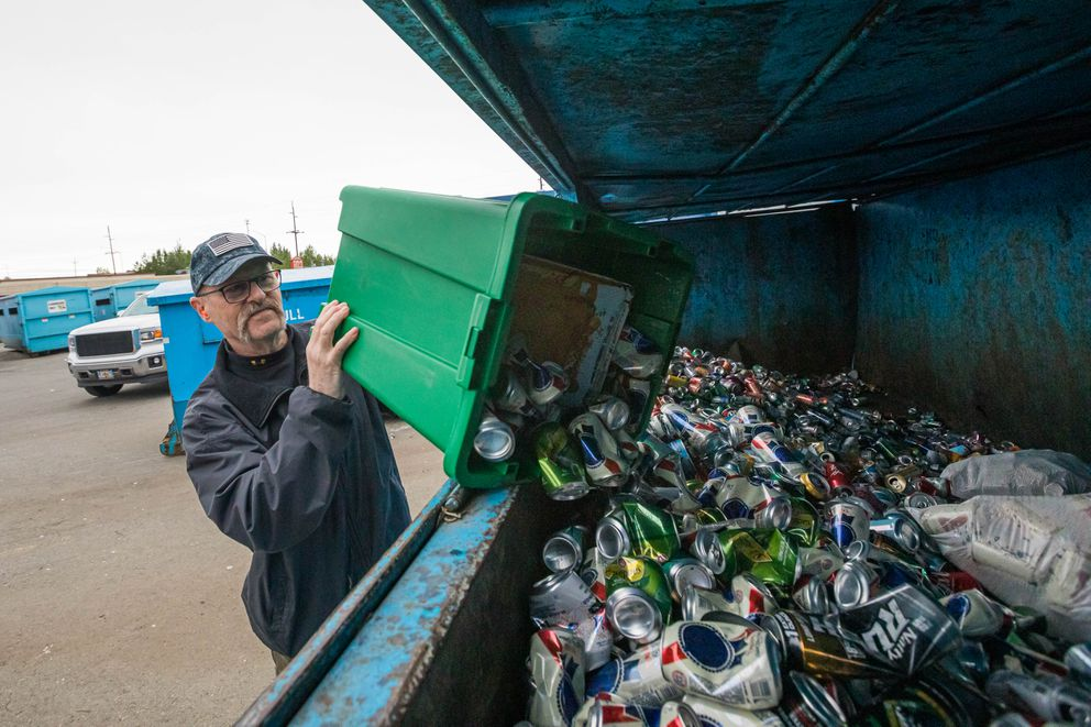 Kevin Tackitt recycles aluminum cans Thursday, May 30, 2019 at the Anchorage Recycling Center. (Loren Holmes / ADN)