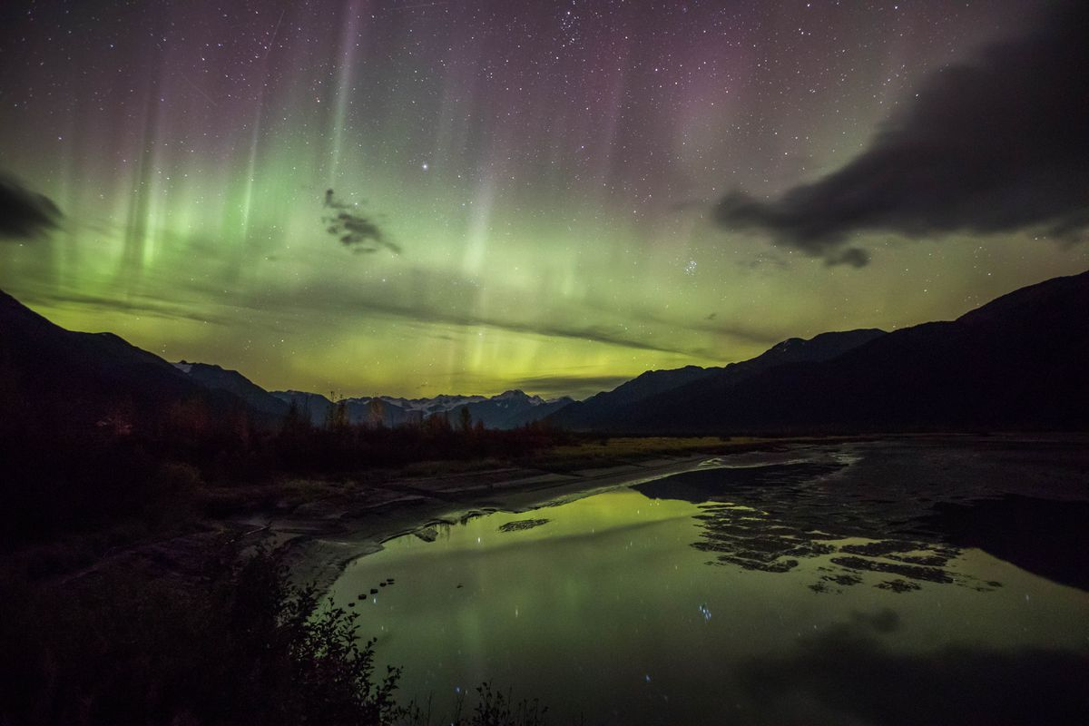 The northern lights make an appearance above Twentymile River along Turnagain Arm on Wednesday night, Sept. 28, 2016. (Loren Holmes / ADN)
