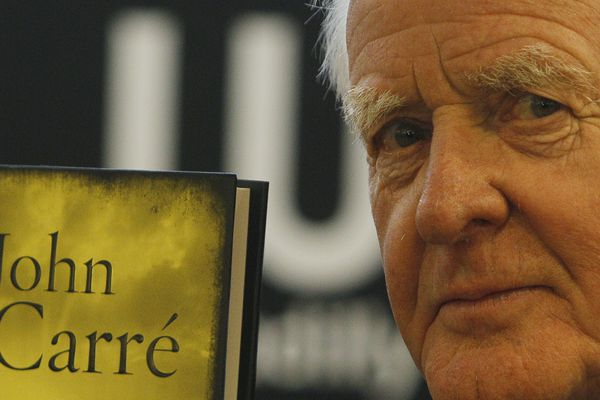 British author John le Carre holds a copy of his new book entitled 'Our Kind of Traitor' at a central London bookstore during a book signing event to mark the launch of the novel in London Thursday, Sept. 16, 2010. John le Carre, the spy-turned-novelist whose elegant and intricate narratives defined the Cold War espionage thriller and brought acclaim to a genre critics had once ignored, has died. He was 89, Le Carre's literary agency, Curtis Brown, said Sunday, Dec. 13, 2020 that he died in Cornwall, southwest England on Saturday. (AP Photo/Alastair Grant, file)