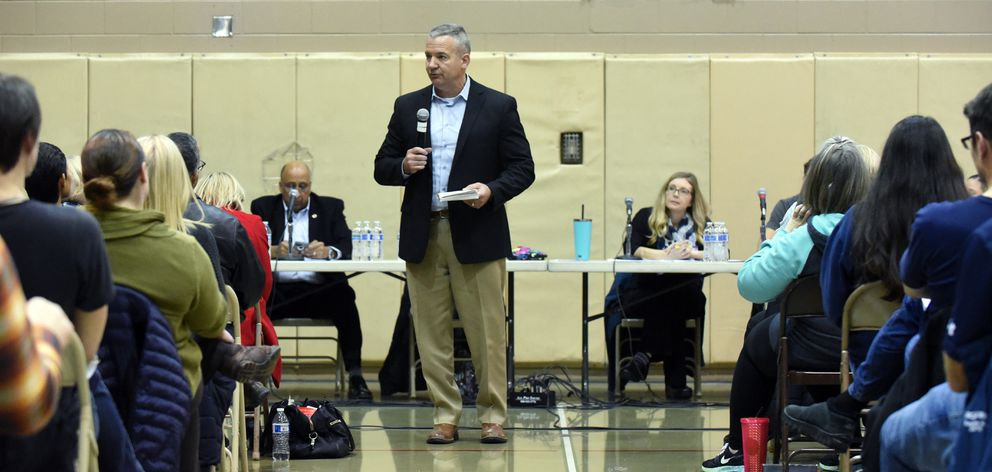 Anchorage School District Chief Operating Officer Tom Roth speaks to the crowd during a public forum on the future of Chugiak-Eagle River schools on Monday, Dec. 9, 2019 at Mirror Lake Middle School in Chugiak. (Matt Tunseth / Chugiak-Eagle River Star)