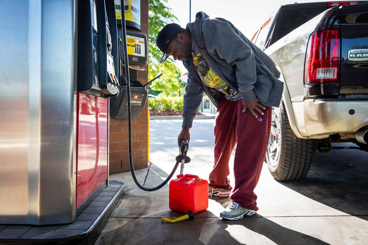 Jerald White fills a gas container at a station in Morrow, Ga., on May 13, 2021, as demand for gasoline surged following a cyberattack on Colonial Pipeline. Photo for The Washington Post by Dustin Chambers